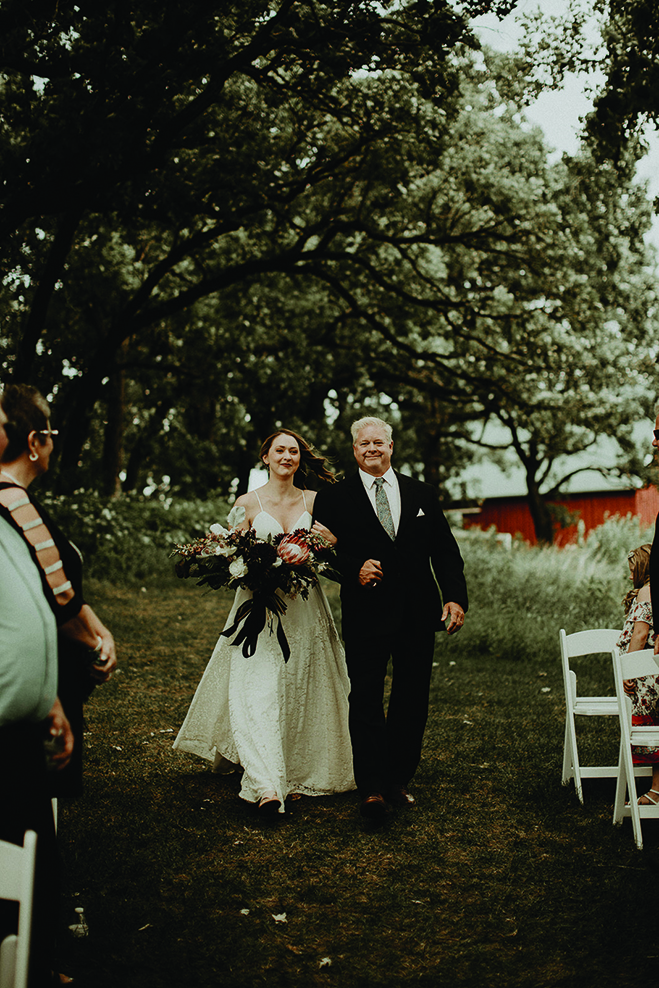 Heidi's father walks her down the aisle at Almquist Farm