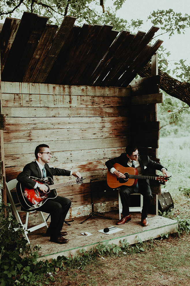 Two guitarists play at Heidi and Erik's wedding in Almquist Farm.