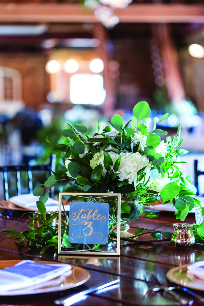 A table setting at Taylor and John's wedding at Historic John P. Furber Farm