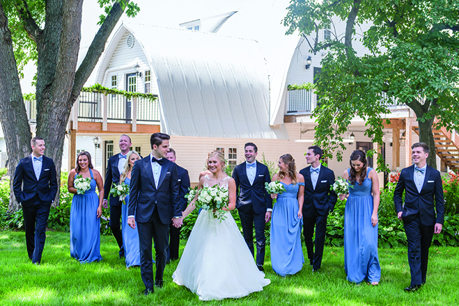 Taylor, John and their wedding party walk the grounds at Historic John P. Furber Farm.