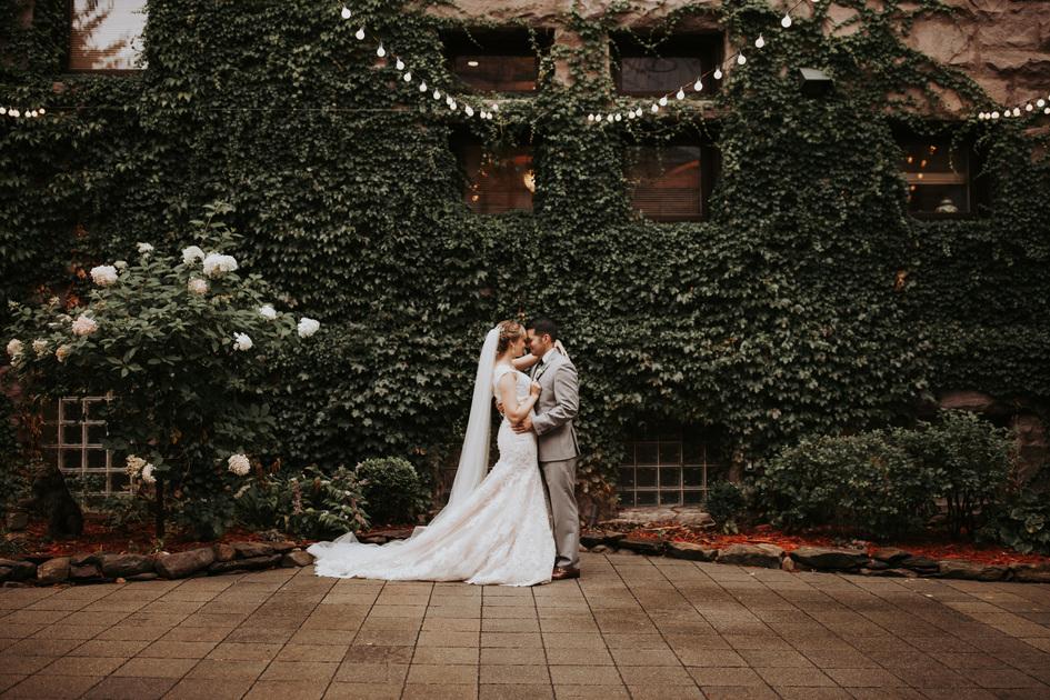 married couple outside Van Dusen Mansion