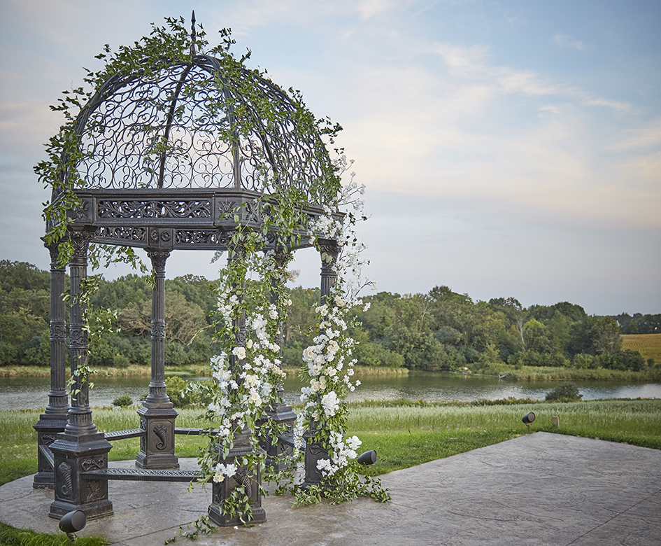 Wedding arch with pastel florals at Bavaria Downs