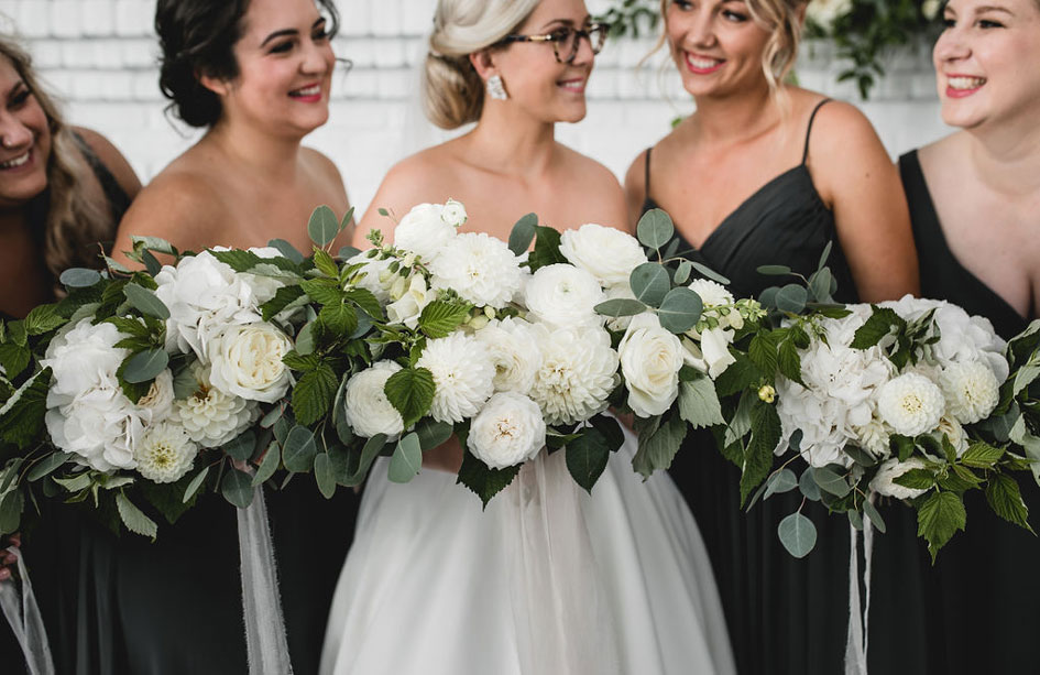 bridesmaids with white bouquets