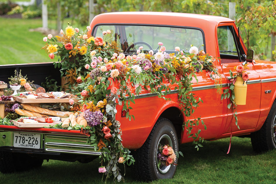 A '50s Chevy truck bedecked with bright florals and resplendent charcuterie.