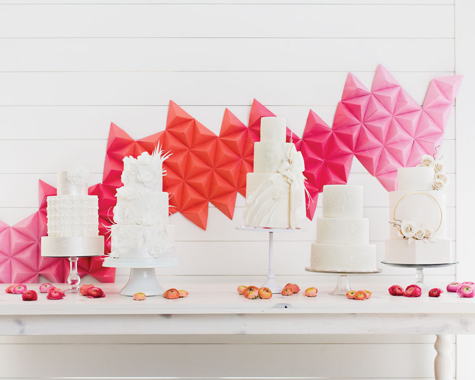 White wedding cakes stand at The Hutton House.