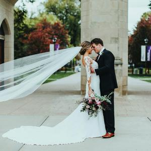 Ashley and Anthony embrace on their wedding day at the University of St. Thomas