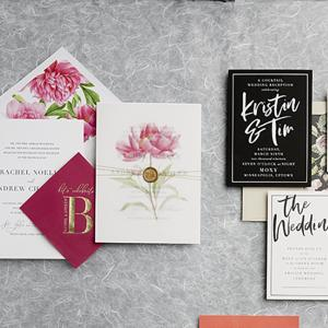 Two wedding invitation examples: pink and gold from Jill Elaine Designs and black and white from Champagne Press