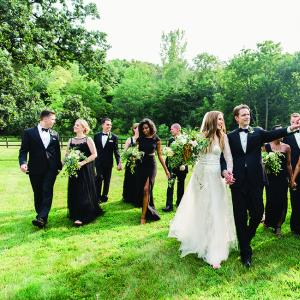 Laura, Rob and their wedding party walk the grounds at Mayowood Stone Barn