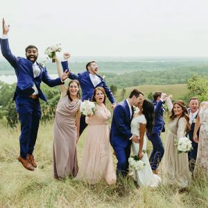 Ruwani and Zach pose with their wedding party at The Hutton House.