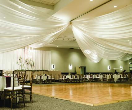 The dance floor and decorated tables at Inwood Oaks, a new wedding venue in Oakdale owned by Mintahoe Catering & Events