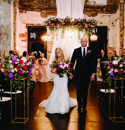 Molly and Seth walk down the aisle during their wedding at Aria.