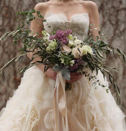 Ruffled wedding dress with large bouquet
