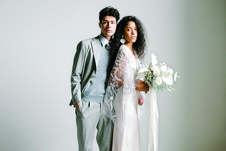 Grays and stark whites make up the bride and groom's attire