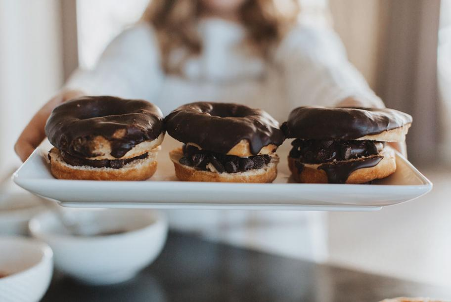 Chocolate frosting on donuts served with Wesley Andrews coffee