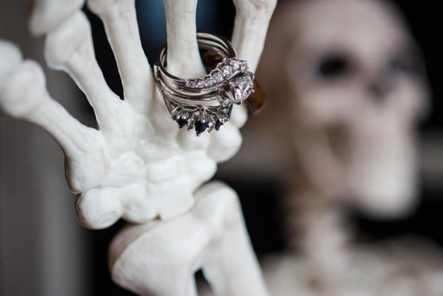 A skeleton displays the bride's rings at the entrance to Mayowood Stone Barn