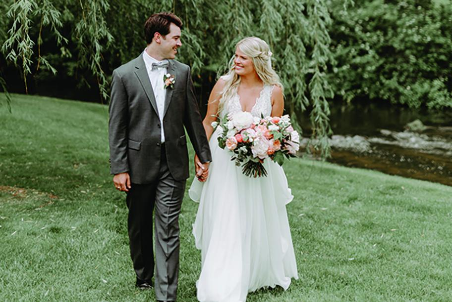 Kate and Lucas walk the grounds at Creekside Farm Weddings & Events