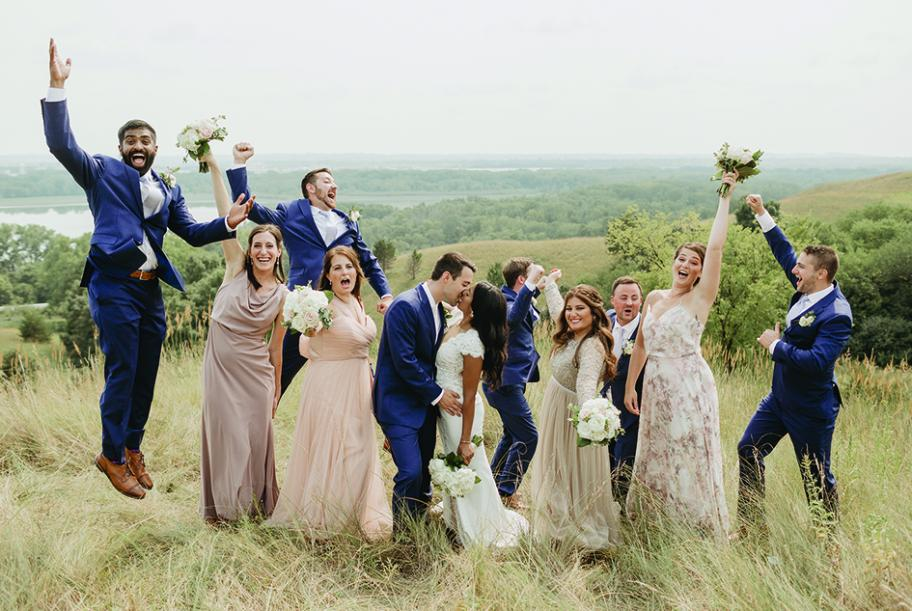 Ruwani Goonetilleke and Zach Sonnentag pose with their wedding party at The Hutton House.
