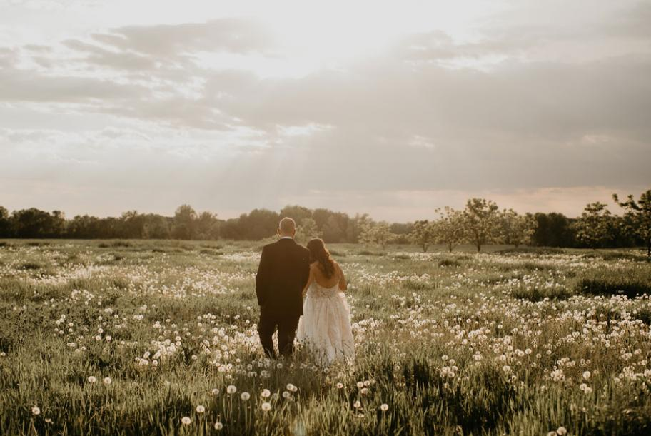 A remote field during golden hour made for stunning photos of the bride and groom.