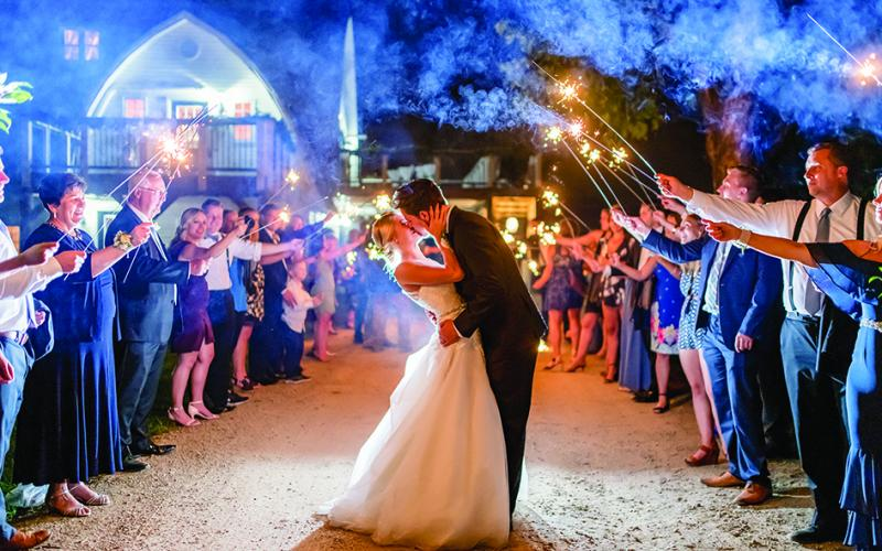 The Historic John P. Furber Farm was filled with light and laughter as these two University of North Dakota alum tied the knot
