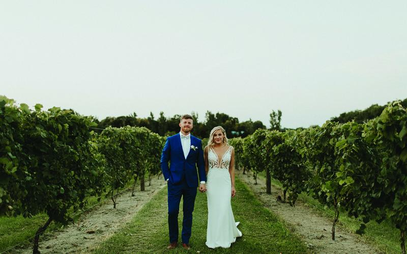 Lindsay and Hunter among the grapes at Carlos Creek Winery