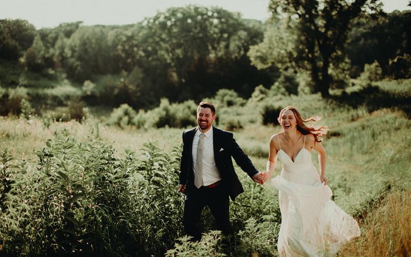 Heidi and Erik walk the grounds at Almquist Farm, a wedding venue in Hastings.