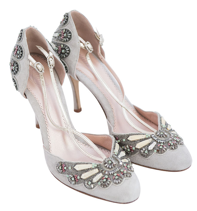 995ec1d5c5b8 Art Deco–inspired brides can evoke Daisy Buchanan in dove gray Emmy London  pumps with crystal and glass beading fanning the toe and heel. Gold leather  ...