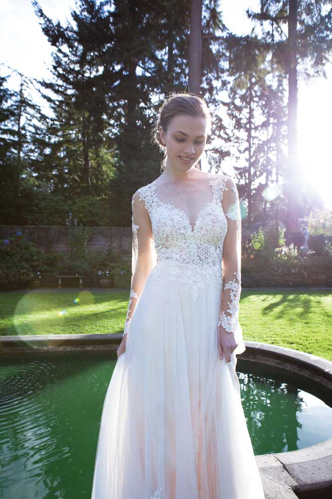 6882c71a65a Essense of Australia illusion lace wedding dress with elegant corded lace  on the bodice and sleeves and a tulle and matte-side luster satin skirt  with a ...